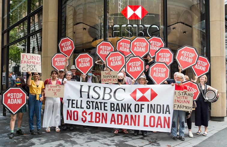 Protesters gather outside the HSBC office in Sydney